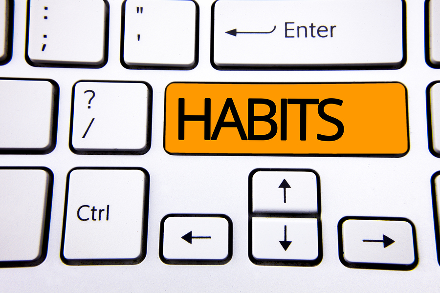 Text sign showing Habits. Conceptual photo Regular tendency or practice Routine Usual Manners Behavior Pattern written Orange Key Button White Keyboard with copy space. Top view.